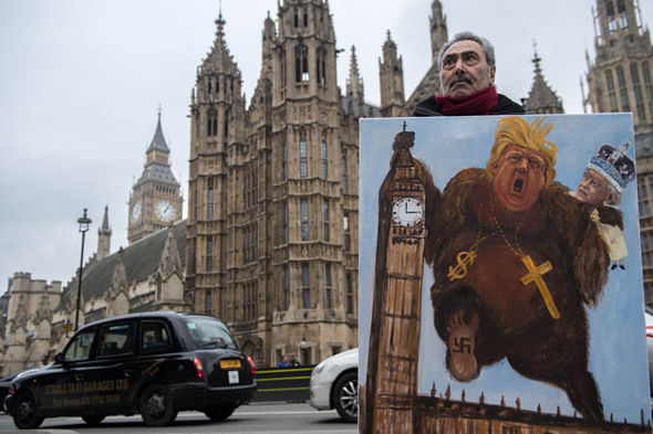 Drawing outside parliament of Trump as King Kong
