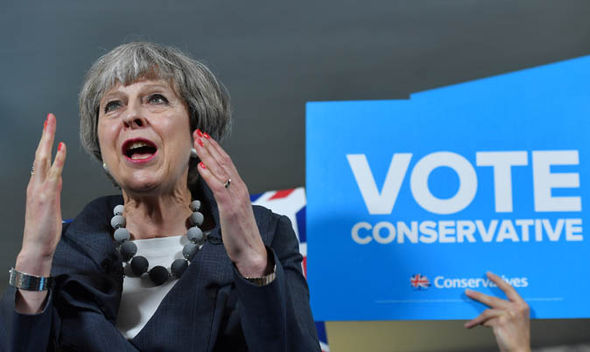 Theresa May campaigning