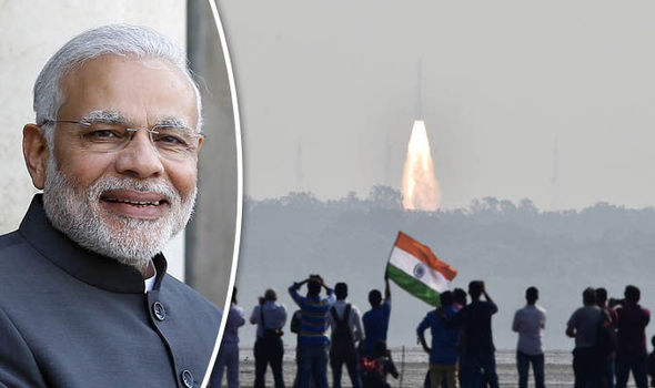 Prime Minister Narendra Modi and launched rocket