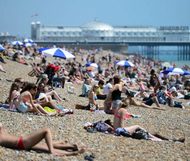 Sunbathers Relax On Brighton Beach Getty May Bank Holiday Weather