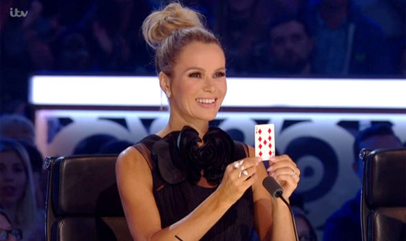 Amanda Holden presents the correct card on Britain's Got Talent