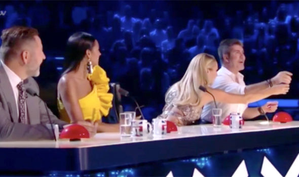 Amanda Holden tried to throw water over Simon Cowell on Britain's Got Talent