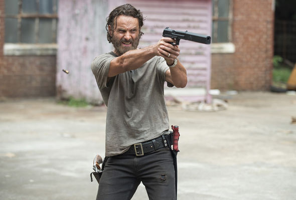 Andrew Lincoln as Rick Grimes pointing gun