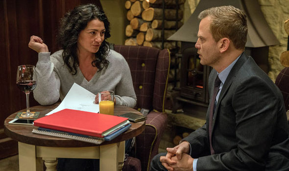 Moira Dingle sits with contractor in The Woolpack