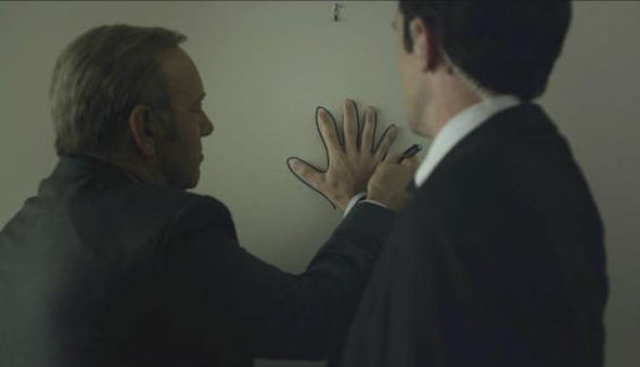House of Cards: Frank tracing Meechum's hand