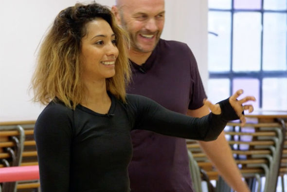 Karen Clifton bites Simon Rimmer during Strictly Come Dancing rehearsals