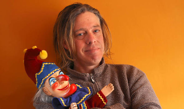 Mark Poulton holding his puppet character Punch