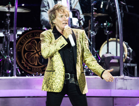 Rod Stewart on stage performing
