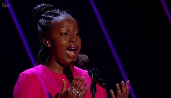 Sarah Ikumu singing