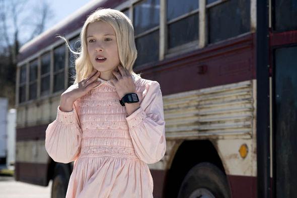Eleven wearing a blonde wig