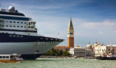 Venice bans cruise ships from historic centre after years of local rage at giant vessels
