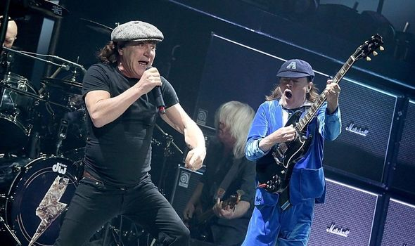 Brian Johnson and Angus Young performing on stage