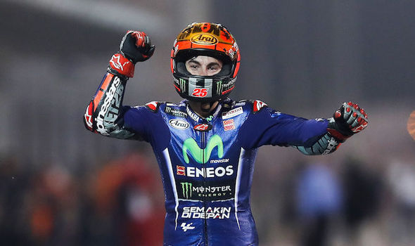 MotoGP rider Maverick Vinales celebrates winning the Qatar Grand Prix for Yamaha