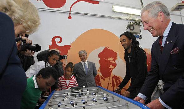 Prince Charles playing table football