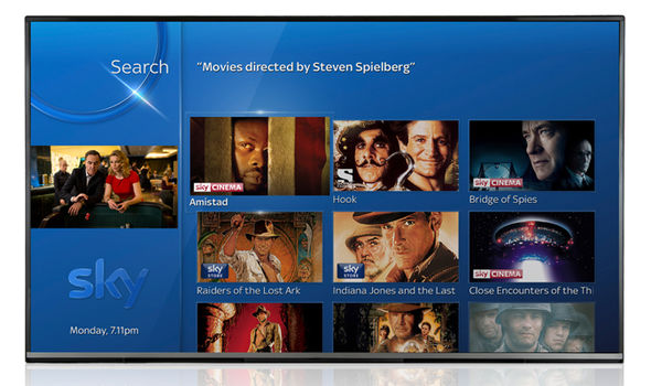 Press and hold the Voice Search button, then ask for movies from your favourite director
