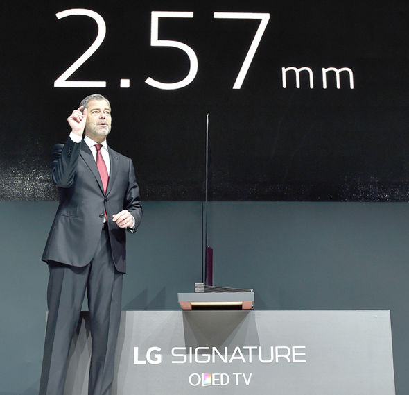 The LG television has the same width as four credit cards stacked on-top of one another