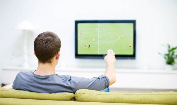 A man watching a TV