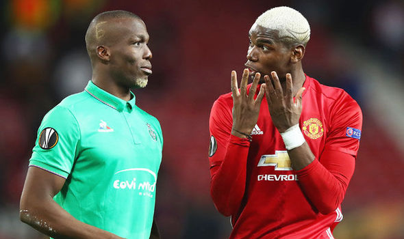 Paul Pogba (right) chats to his brother during the Europa League
