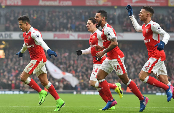 Arsenal players celebrate Hull goal