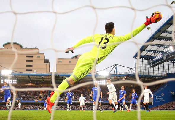 Thibaut Courtois saves a shot for Chelsea