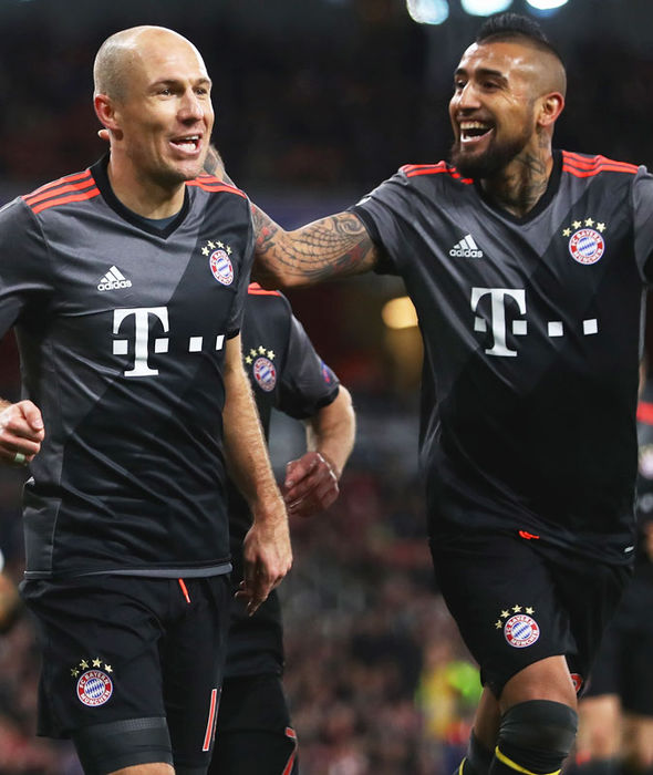 Arjen Robben celebrates his goal against Arsenal with Arturo Vidal