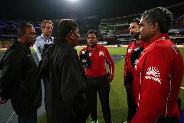 IPL umpires discuss the rain in Bengaluru