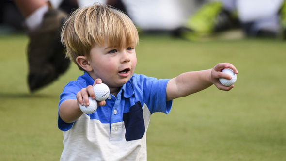 Dustin Johnson's son Tatum