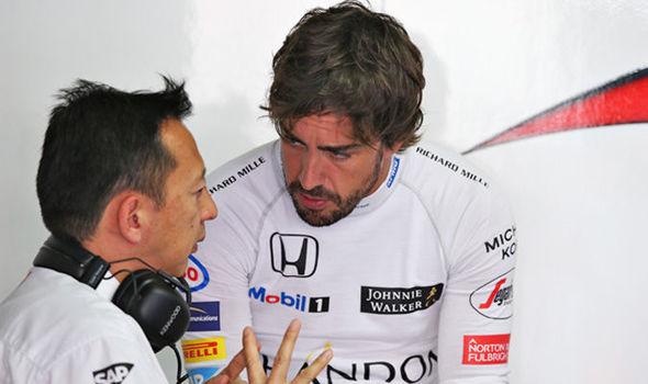 McLaren driver Fernando Alonso and Honda boss Yusuke Hasegawa