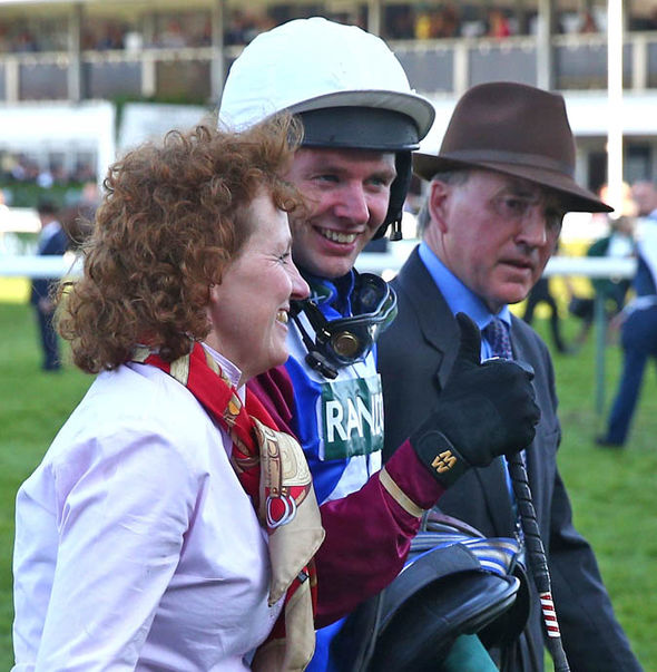 Jockey Derek Fox (Middle) and trainer Lucinda Russell celebrate the win