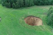 russia giant sinkhole opens in farmer field