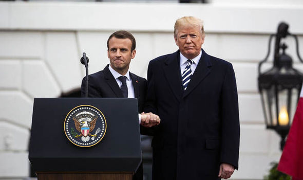 Emmanuel Macron, France's president, left, shakes hands with U.S. President Donald Trump