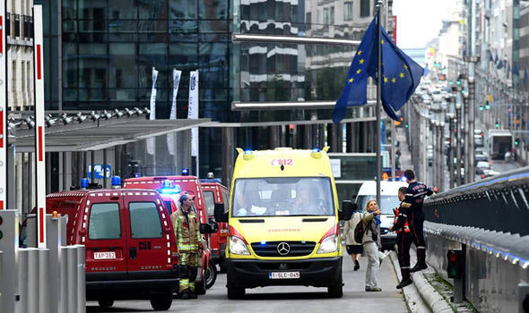 Emergency services vehicles at the European Council building