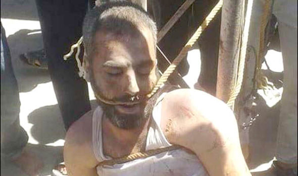 ISIS militant bound with rope before crucifixion