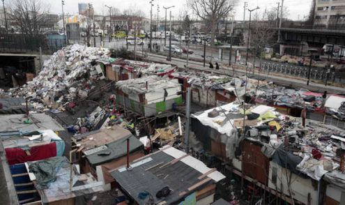 Migrants angry as they are removed from Paris camp by police   World     Migrant huts in Paris