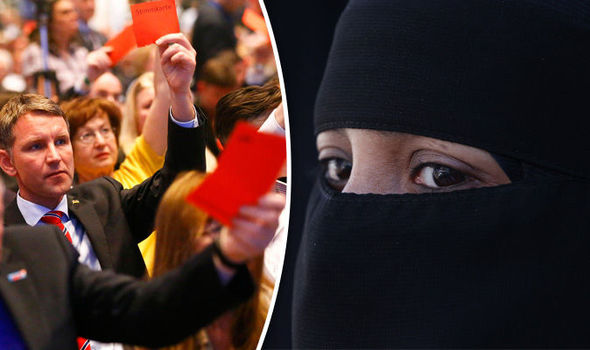 Woman in burqa and crowd