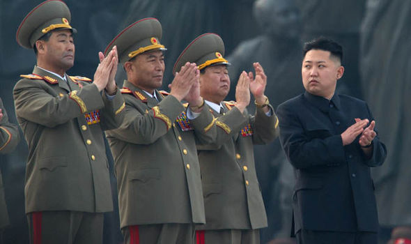 Kim Jong-un with his generals