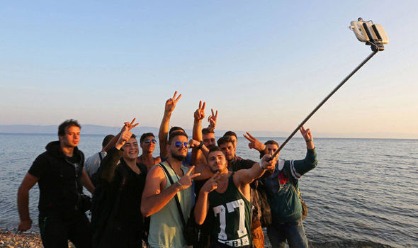A group of Syrian men pose for snap using selfie stick