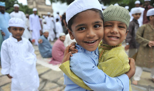 Ramadan: Muslim boys hugging on Eid al-Fitr