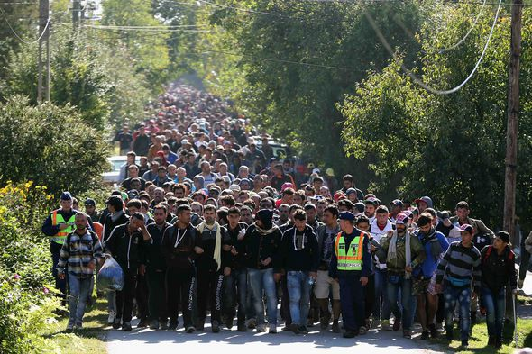Migrants passing into Austria from Hungary