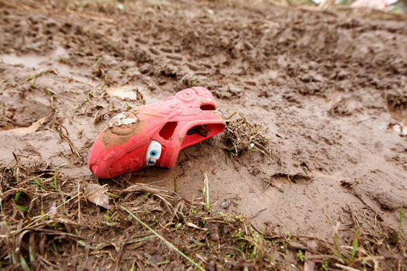 Child shoe left in the mud