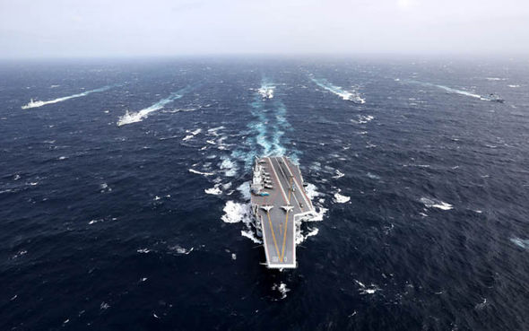 Aircraft carrier and escort in the South China Sea