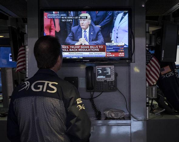 A stock broker watching Donald Trump's Bill