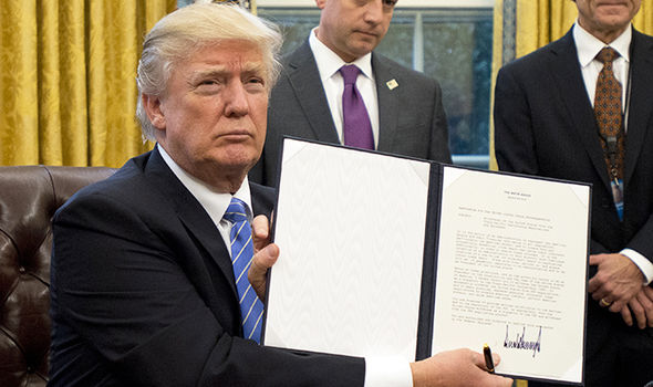 Donald Trump signing TPP removal