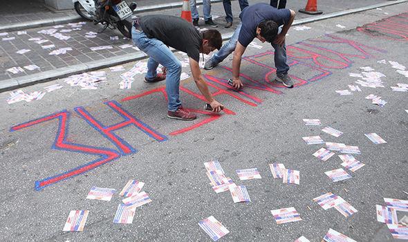 Greeks protest over IMF deals