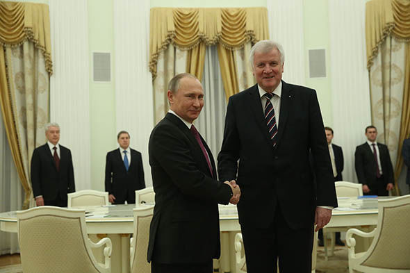Horst Seehofer and Vladimir Putin