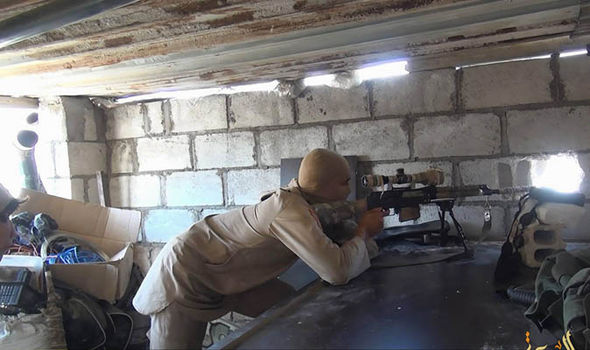 An ISIS sniper in a building