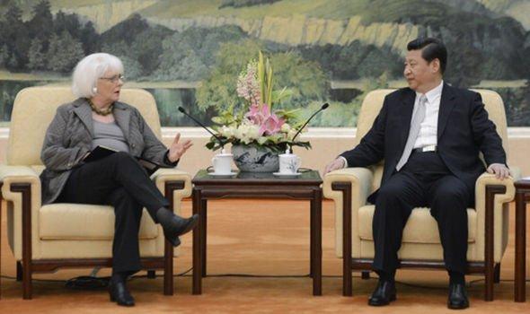 Icelandic Prime Minister Johanna Sigurdardottir (left) speaks with Chinese President Xi Jinping