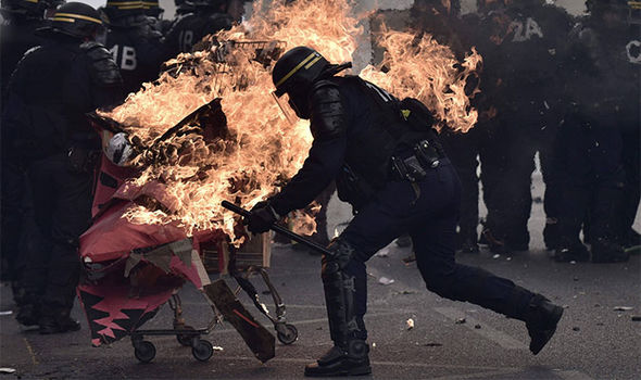 Fire with French CRS anti-riot police officers