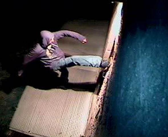 Joseph Giaquinto kicking the door of a mosque