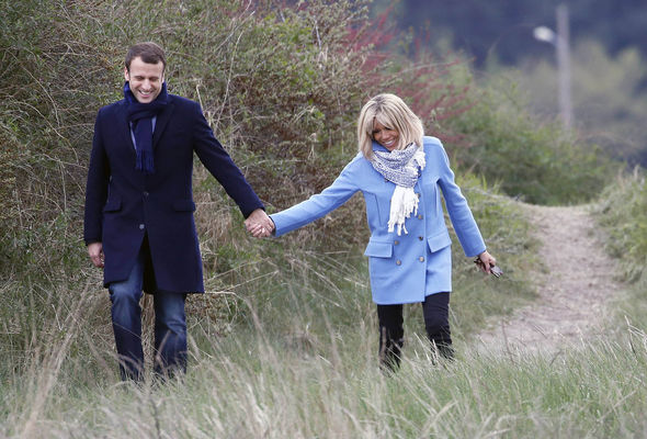 Emmanuel Macron and his wife Brigitte are seen taking a walk on the eve of the first round vote